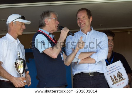 LECTOURE, FRANCE - JUNE 20   Daniel Mangeas interviewes Christian Prudhomme at the departure of the first stage of the Route du Sud, on June 20, 2014 in Lectoure, France   - stock photo
