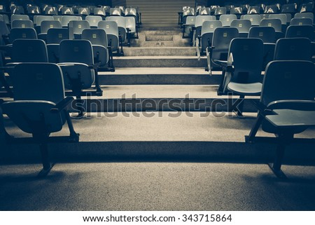 Lecture chairs in a class room with stair path in the middle of a class - stock photo