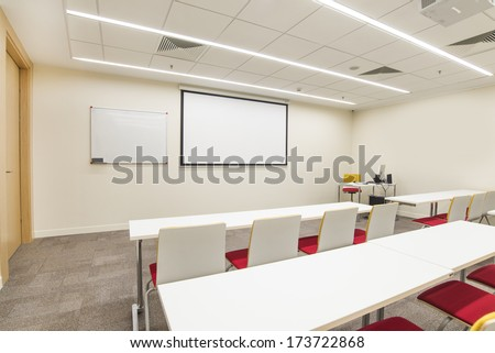 lecture hall with TV projector - stock photo