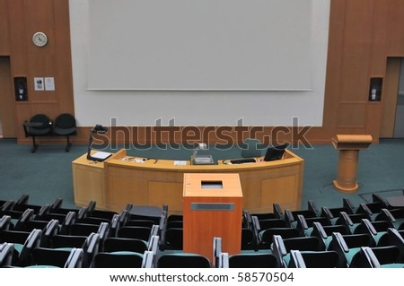 Lecture theater showing white screen. For concepts such as school and education, business and training, and meetings and conferences. - stock photo