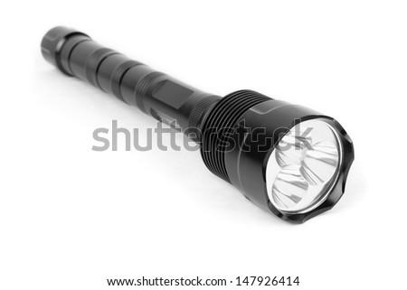 LED black flashlight isolated on white background - stock photo