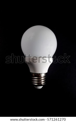 LED Bulb isolated on dark background. Copy space. Idea concept