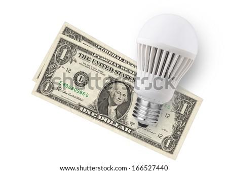 LED bulb over dollar bills isolated on white background - stock photo