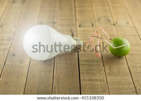 LED bulbs on wood background,Energy saving concept,Natural energy concept,Energy saving bulb. - stock photo