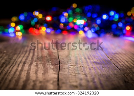 LED Christmas lights on wooden background, abstract template - stock photo