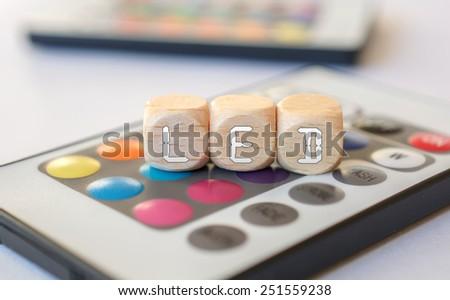 LED-Cube Acronym On LED Remote - stock photo