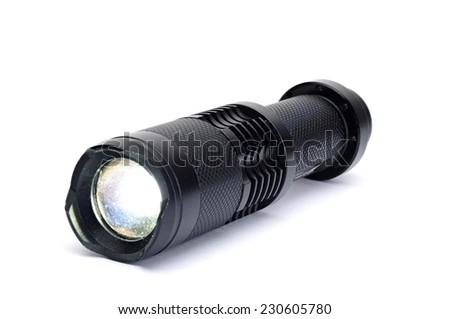 LED flashlight isolated on a white background - stock photo