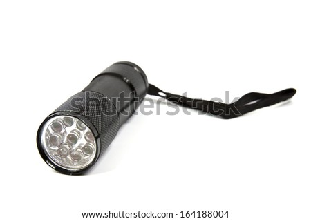 LED flashlight with aluminum body and hand strap on a white background - stock photo