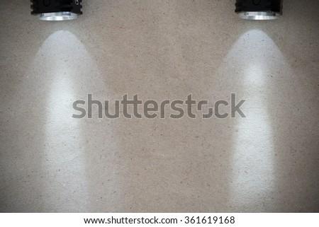 LED flashlight with beam on wooden background - stock photo