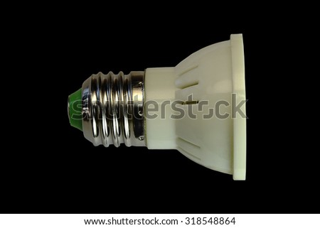 LED lamp isolated on a black  background  with clipping path. Closeup with no shadows.  5 watts.  Energy-saving technology. The lamp with a conventional socket.  - stock photo