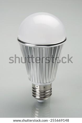 LED light bulb with grey plain background - stock photo