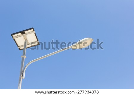 Led lighting and solar panel with blue sky background. - stock photo