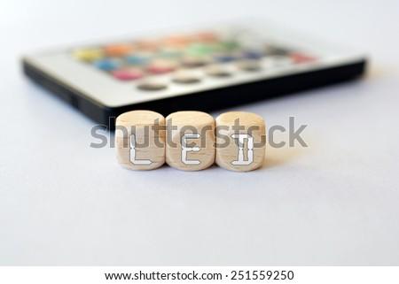 LED Remote With LED-Cube Acronym - stock photo