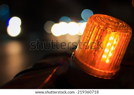 LED signal side of the road is under construction and Bokeh blur of car lights on street at night.  - stock photo