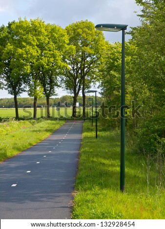 LED Street Lighting along a Cycling Track with Low Dispersal Light Pollution, Ideal for Migrating Bats and other Night Life - stock photo