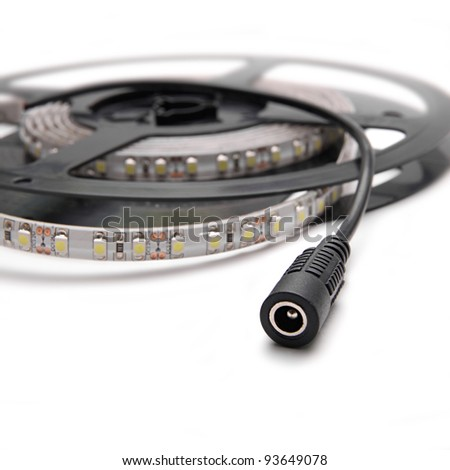 LED strip with connection cable on roll isolated on white - stock photo