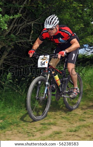 LEDBURY, UK-JUNE 19:An unidentified disabled racer with artificial limb in the  24 hour 2010 Mountain Mayhem mountain bike competition: June 19, 2010 in Ledbury UK - stock photo