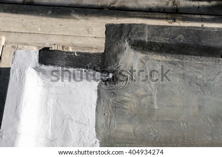 ledge of a roof with waterproofing and paint - stock photo
