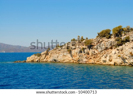 Ledge of one of island in a bay of Aegean sea