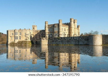 Leeds Castle across the moat with reflection. - stock photo
