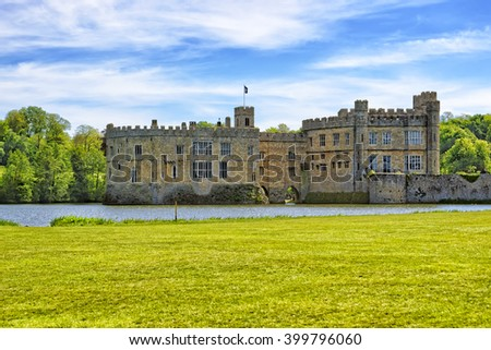 Leeds Castle in an island on the lake in Kent in England. The castle was built in the twelfth century as a king residence. Now it is open to the public. - stock photo