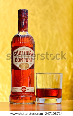 LEEDS - JANUARY 26: Southern Comfort whiskey on a golden background. January 26, 2015 in Leeds, UK. - stock photo