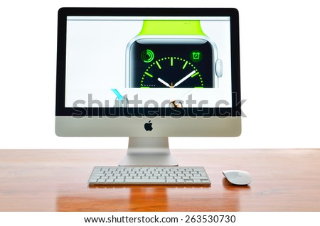 LEEDS - MARCH 25: Apple iMac with the new iWatch displayed on the screen.  March 25, 2015 in Leeds Yorkshire, UK. - stock photo