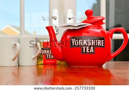 LEEDS - MARCH 04 : Yorkshire Tea teapot and teacups, 2015 in Leeds, UK. - stock photo