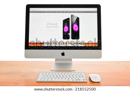 LEEDS - SEPTEMBER 17: Apple iMac with the new iPhone 6 displayed on the screen.  September 17, 2014 in Leeds Yorkshire, UK. - stock photo