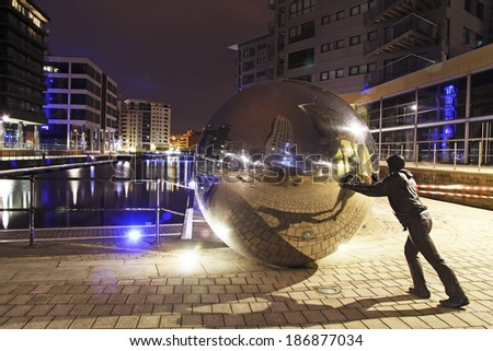 LEEDS, UK - APRIL 12: New Dock, Leeds, 12 April 2014. New Dock (formerly Clarence Dock) is a mixed development with retail and office spaces with above waterside apartments. - stock photo
