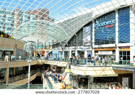LEEDS, UK - APRIL 17, 2015: People shop inside the Trinity shopping centre, major commercial area of the city of Leeds, England. - stock photo