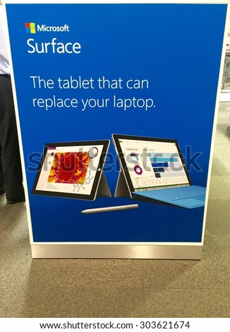 LEEDS,UK - 6 AUGUST 2015.  Microsoft Surface Tablet pc in store advertising inside PC World after launch of Windows 10. - stock photo