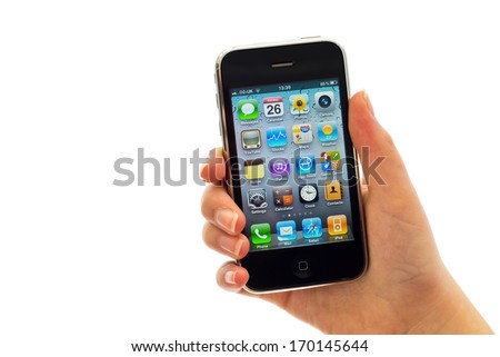 LEEDS, UK - FEBRUARY 26, 2012: Apple iPhone in a female hand, the iPhone is one of the most popular smart phones in the world. - stock photo