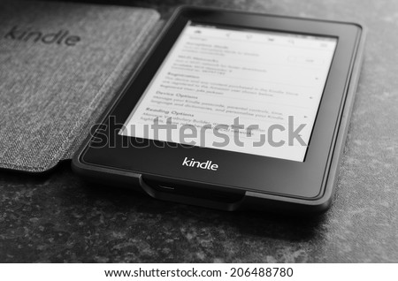 LEEDS, UK - JULY 16: Amazon Kindle paper white e book reader. July 16, 2014 in Leeds, UK. - stock photo