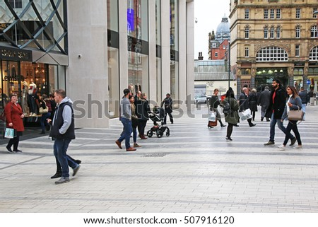 LEEDS, UK - OCTOBER 30, 2016: Shoppers entering and leaving the new Victoria Gate shopping centre. Victoria Gate is a 165 million pound retail development which opened on 21 October 2016