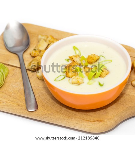 Leek and Potato soup with croutons. Selective focus. - stock photo