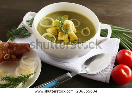 Leek soup on table, close up - stock photo