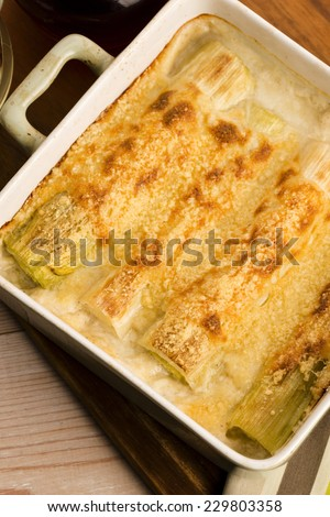 Leeks casserole with white sauce and cheese - stock photo