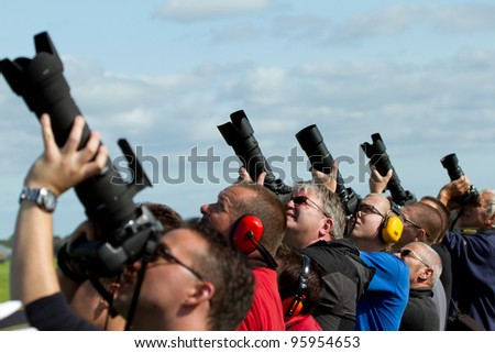 LEEUWARDEN,FRIESLAND,HOLLAND-SEPTEMBER 17: A group of unidentified hotographers are photographing airplanes at the Airshow on September 17, 2011 at Leeuwarden Airfield