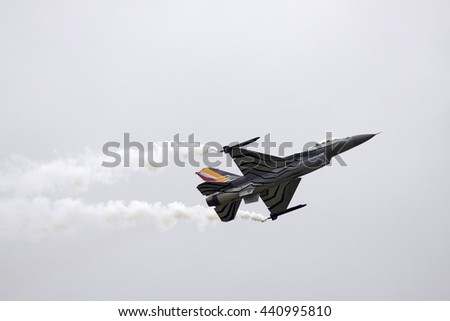 LEEUWARDEN, NETHERLANDS - JUNI 11 2016:F16 fighter jet of the Belgian Air Force, performs a demonstration flight during an air show on juni 11 ,2016 in Leeuwarden  - stock photo