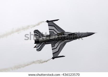 LEEUWARDEN, NETHERLANDS - JUNI 11 2016: Underside of a jet during the air show in Leeuwardenon juni 11 ,2016 in Leeuwarden. - stock photo