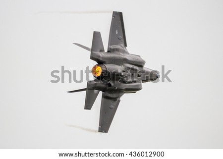 LEEUWARDEN, THE NETHERLANDS - JUN 10, 2016: A F-35 Lightning II flyby on it's European debut at the Royal Netherlands Air Force Days - stock photo