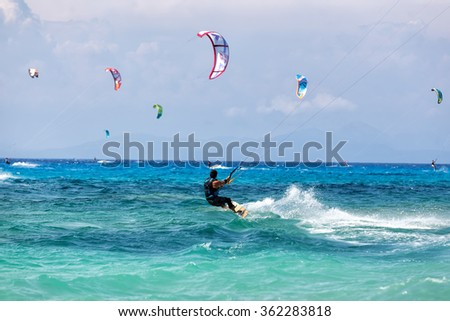 Lefkada, Greece, August 12 2015: Kitesurfers on the Milos beach in Lefkada. Milos beach is most popular places in Greece for kitesurfing. - stock photo