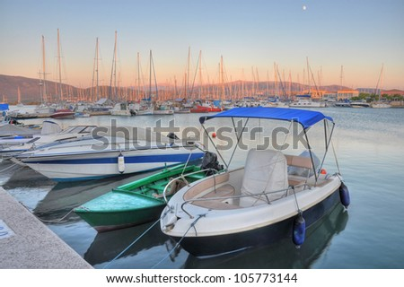 Lefkada port, in Greece, surprised at sunset, with a beautiful sky in the background. - stock photo