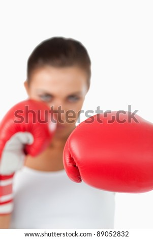 Left fist of female boxer against a white background