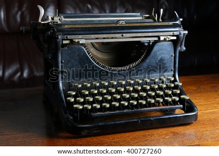 left front of Historic black typewriter on the wooden table