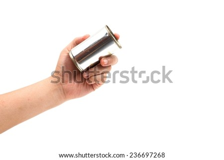 left hand holding canned food isolated on white