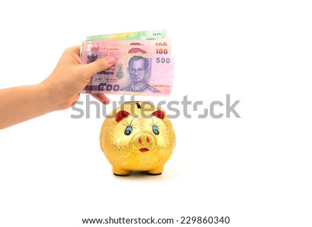 left hand holding thailand paper currency and piggy bank isolated on white