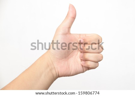 Left hand thumb up - stock photo