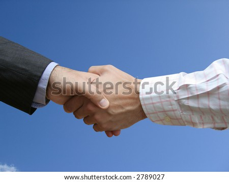 Left-handed handshake with the sky
